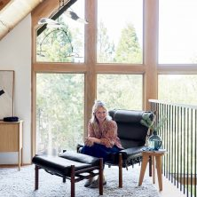 Interior designer Emily Henderson and her Inca chair handmade in Sweden by Norell Furniture. Design: Arne Norell.